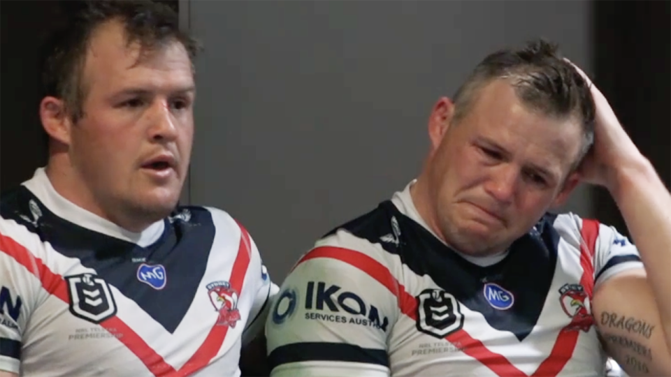 Sydney Roosters star Brett Morris (right) broke down after suffering a serious knee injury on Saturday night, consoled by brother Josh Morris. Picture: Fox League