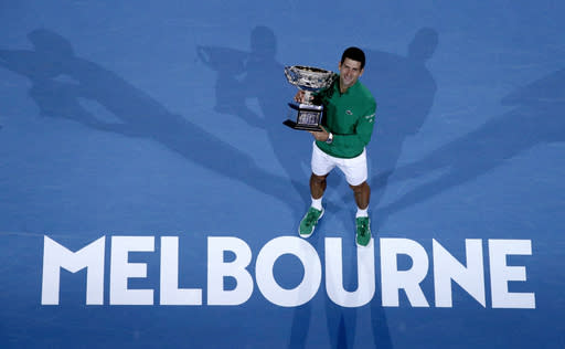 "FILE - In this Feb. 3, 2020, file photo, Serbia's Novak Djokovic holds the Norman Brookes Challenge Cup after defeating Austria's Dominic Thiem in the men's singles final of the Australian Open tennis championship in Melbourne, Australia. The political leader of Australia's Victorian state says Wednesday, Nov. 18, 2020, despite ""incredibly complex"" negotiations, he is confident January's Australian Open tennis tournament will proceed. (AP Photo/Andy Wong)"
