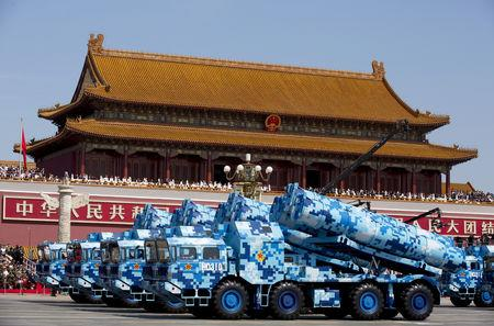 FILE PHOTO - Military vehicles carry DF-10 ship-launched cruise missiles as they travel past Tiananmen Gate during a military parade to commemorate the 70th anniversary of the end of World War II in Beijing Thursday Sept. 3, 2015.    Andy Wong/Pool via REUTERS/File Photo