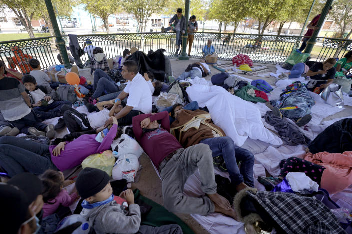 """A group of migrants rest on a gazebo at a park after they were expelled from the U.S. and pushed by Mexican authorities off an area where they had been staying, Saturday, March 20, 2021, in Reynosa, Mexico. The fate of thousands of migrant families who have recently arrived at the Mexico border is being decided by a mysterious new system under President Joe Biden. U.S. authorities are releasing migrants with """"acute vulnerabilities"""" and allowing them to pursue asylum. But it's not clear why some are considered vulnerable and not others. (AP Photo/Julio Cortez)"""