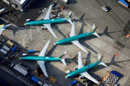 An aerial photo shows Boeing 737 MAX airplanes parked on the tarmac at the Boeing Factory in Renton