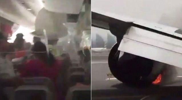 Children were among 300 screaming people who are seen fleeing the cabin of an Emirates plane. Photo: Twitter