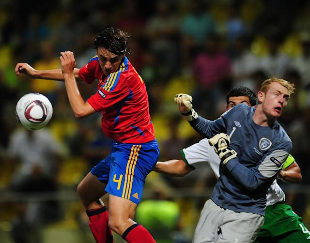 Ignasi Miguel (L) of Spain vies for the ball with goalkeeper Aaron McCarey (R) of Ireland during their UEFA European Under-19 Championship football match, near the village of Chiajna village, outside of Bucharest, on July 29, 2011. AFP PHOTO/DANIEL MIHAILESCU (Photo credit should read DANIEL MIHAILESCU/AFP/Getty Images)