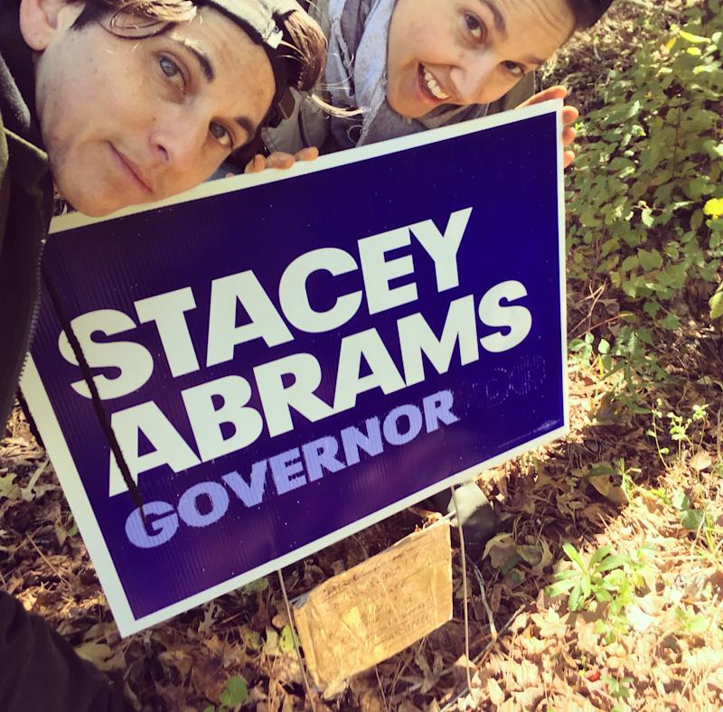 Katie and I taking a selfie in front of our second Stacey Abrams sign to replace the one that was stolen, Eatonton, Georgia, in October 2018. (Courtesy of Mel Plaut)