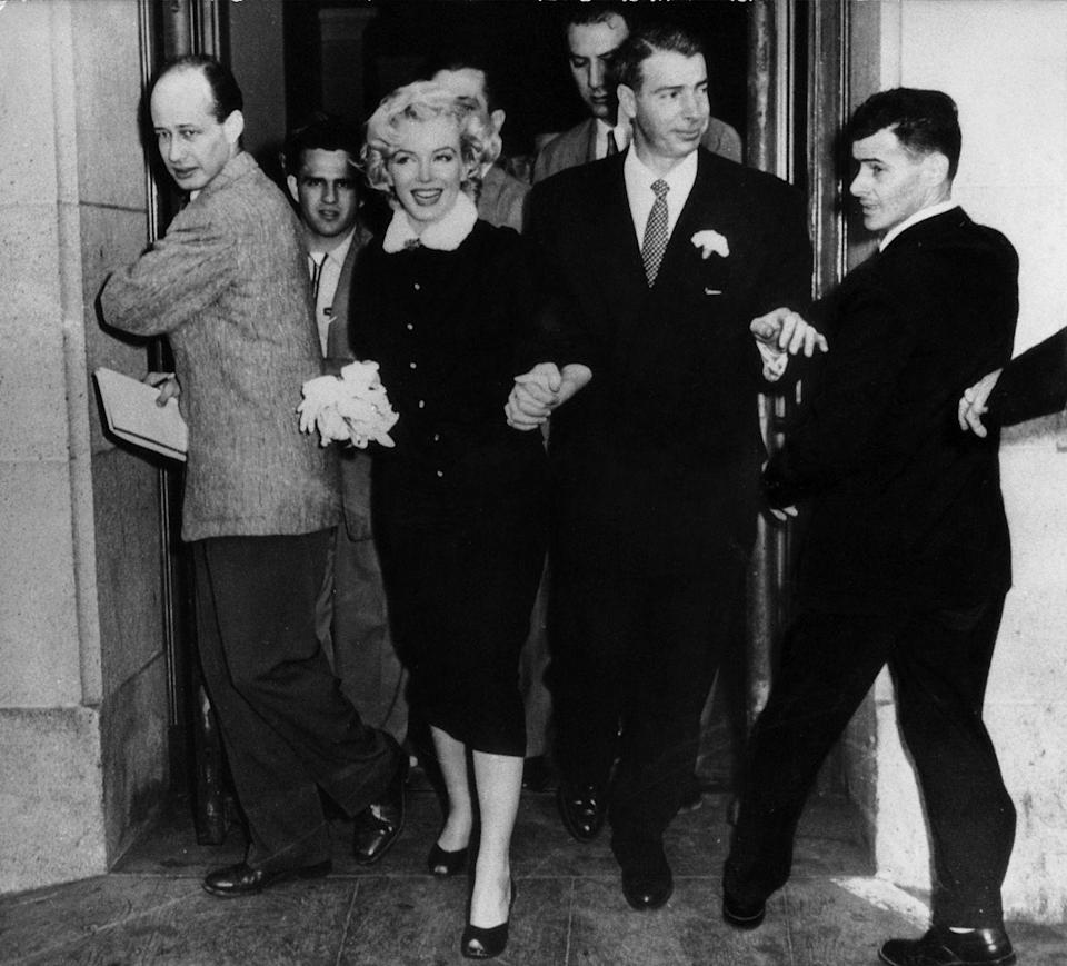 <p>Marilyn married Joe DiMaggio in January. They're coming out of the courthouse where the ceremony was held. </p>