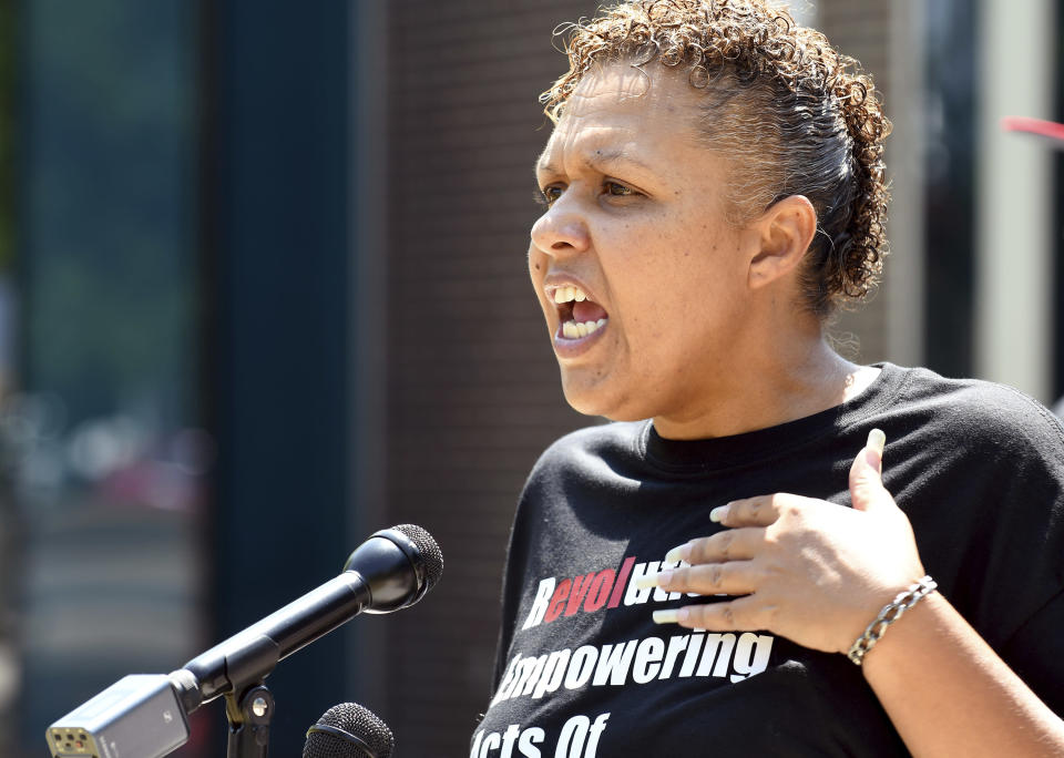 Community activist Candice Bailey speaks during a news conference in Aurora, Colorado, on Wednesday, July 28, 2021. Local activists and former members of Aurora's community police task force gathered to call attention to police brutality. Aurora police announced Monday that an officer was arrested after video showed him using his pistol to beat a man he was trying to take into custody, choking him and threatening to kill him, while another officer was accused of failing to stop her colleague. (AP Photo/Thomas Peipert)