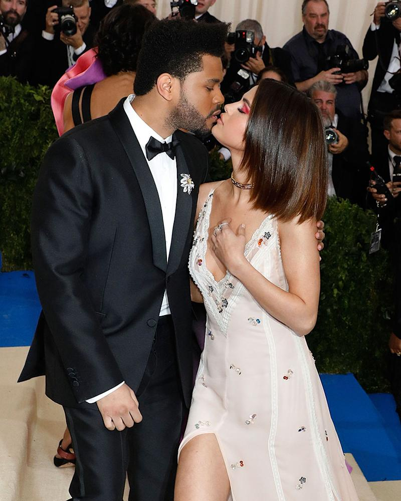 The Weeknd kisses Selena Gomez at