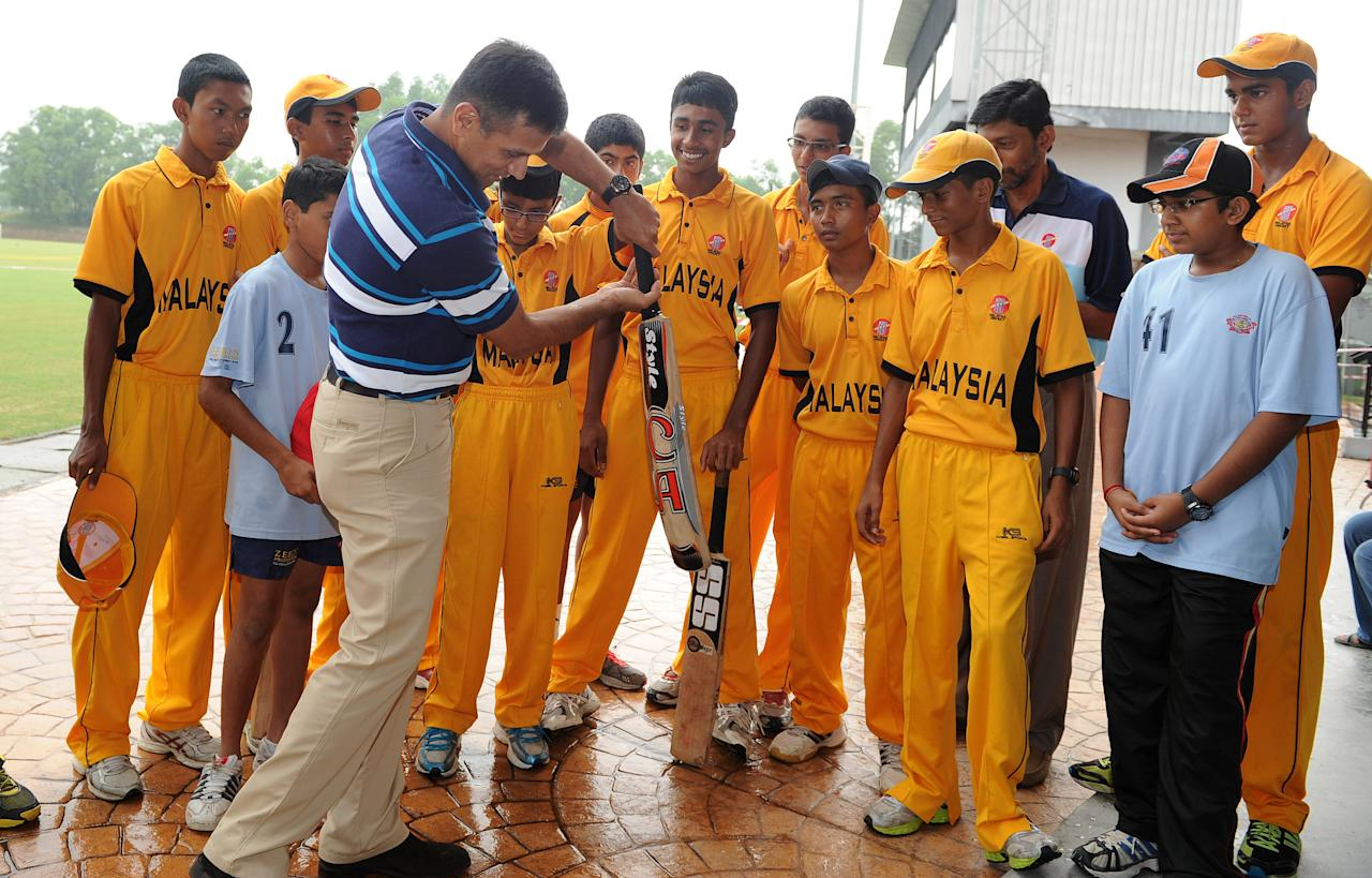 KUALA LUMUR, MALAYSIA - JUNE 27:  Indian cricket player, Rahul Dravid attends a clinic with local young cricket players as part of the 2012 ICC Annual Conference at Kinrara Oval on June 27, 2012 in Kuala Lumpur, Malaysia.  (Photo by Arep Kulal/Getty Images)