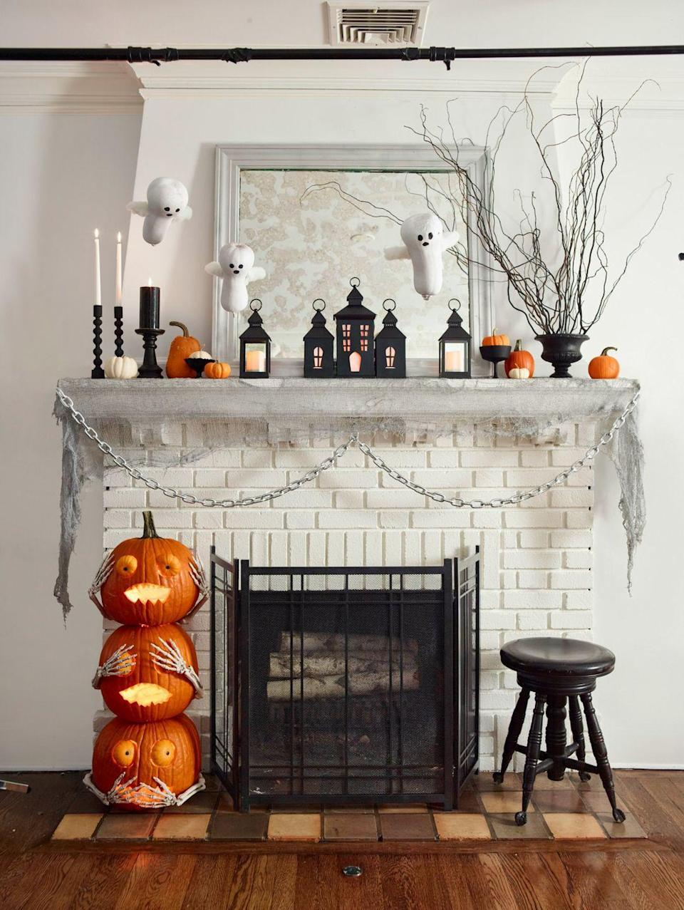 """<p>What you don't know can't hurt you, right? This stacked-pumpkin statue — complete with Jack Be Little eyes and faux-skeleton arms — denies any wrongdoing around the house. </p><p><strong>What You'll Need:</strong> <a href=""""https://www.amazon.com/Skeleton-Hands-Stakes-Halloween-Decor/dp/B00LW34IH0?ref_=fsclp_pl_dp_2&tag=syn-yahoo-20&ascsubtag=%5Bartid%7C10070.g.1279%5Bsrc%7Cyahoo-us"""" rel=""""nofollow noopener"""" target=""""_blank"""" data-ylk=""""slk:Skeleton arms"""" class=""""link rapid-noclick-resp"""">Skeleton arms</a> ($8, Amazon); <a href=""""https://www.amazon.com/Ehdching-Artificial-Realistic-Halloween-Decoration/dp/B01JLRL63M?ref_=fsclp_pl_dp_1&tag=syn-yahoo-20&ascsubtag=%5Bartid%7C10070.g.1279%5Bsrc%7Cyahoo-us"""" rel=""""nofollow noopener"""" target=""""_blank"""" data-ylk=""""slk:mini pumpkins"""" class=""""link rapid-noclick-resp"""">mini pumpkins</a> ($13, Amazon)</p>"""