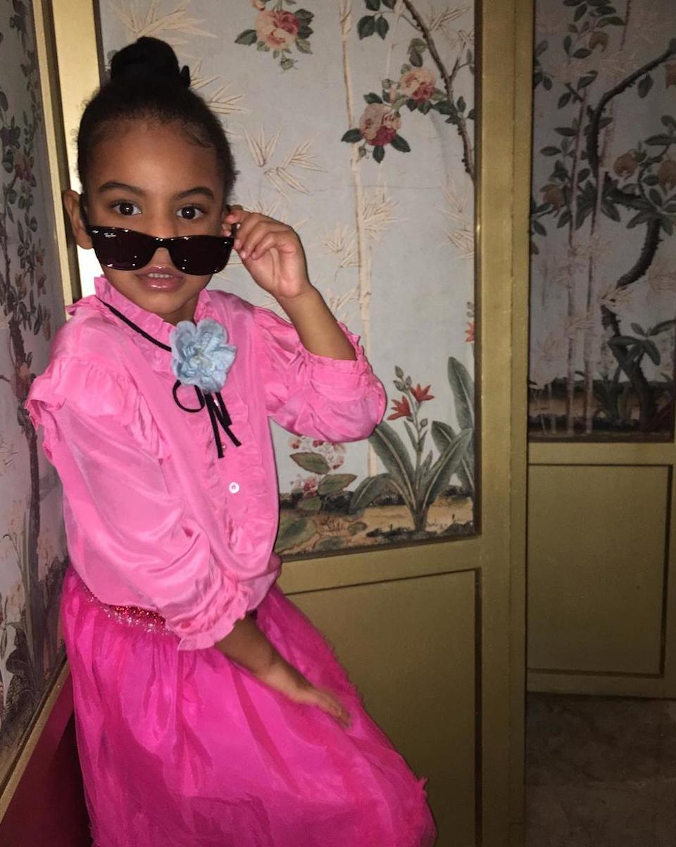 """<p>In a 'gram by Aunt Solange, little Blue lets her inner diva free and adds a pair of chic Ray-Ban sunnies to her pink ensemble that she holds sassily on her face. """"(Ps: She does her OWN photo edits/selections...as she should) #proudauntie,"""" <a rel=""""nofollow noopener"""" href=""""https://www.instagram.com/p/BIF5jhkgOwI/?taken-by=saintrecords"""" target=""""_blank"""" data-ylk=""""slk:Solange wrote"""" class=""""link rapid-noclick-resp"""">Solange wrote</a>.</p>"""