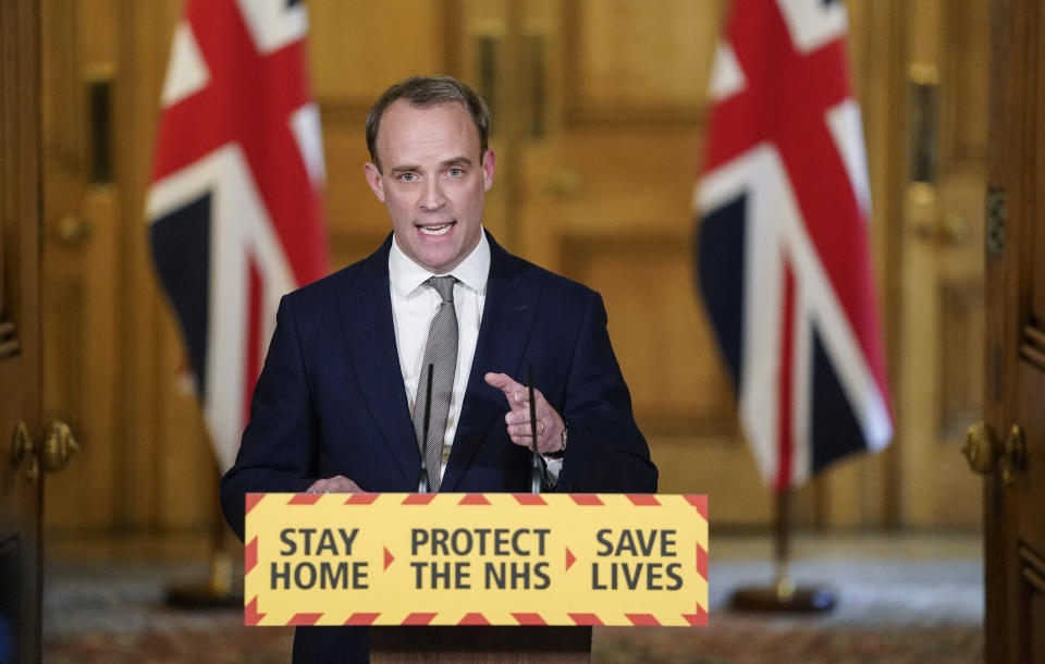 In this photo made available by 10 Downing Street, Britain's Foreign Secretary Dominic Raab gestures during a coronavirus media briefing at 10 Downing Street, in London, Thursday April 16, 2020. The British government says a nationwide lockdown imposed to slow the spread of the new coronavirus will remain in place for at least three more weeks. (Andrew Parsons/10 Downing Street/ via AP)