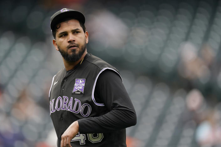 Colorado Rockies starting pitcher German Marquez checks the scoreboard as he heads to the dugout after being pulled form the mound following his walk to San Francisco Giants' Mike Tauchman in the first inning of game one of a baseball doubleheader Tuesday, May 4, 2021, in Denver. (AP Photo/David Zalubowski)