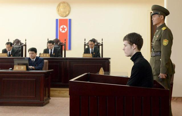 """U.S. citizen Matthew Todd Miller (2nd R) sits in a witness box during his trial at the North Korean Supreme Court in Pyongyang September 14, 2014, in this photo released by Kyodo. North Korea sentenced Miller to six years hard labour for committing """"hostile acts"""" as a tourist to the country, a statement carried by state media said on Sunday. Miller, from Bakersfield, California, and in his mid-20s, entered North Korea in April this year whereupon he tore up his tourist visa and demanded Pyongyang grant him asylum, according to a release from state media at the time. Mandatory credit. REUTERS/Kyodo (NORTH KOREA - Tags: POLITICS CRIME LAW) ATTENTION EDITORS - THIS IMAGE HAS BEEN SUPPLIED BY A THIRD PARTY. IT IS DISTRIBUTED, EXACTLY AS RECEIVED BY REUTERS, AS A SERVICE TO CLIENTS. MANDATORY CREDIT. JAPAN OUT. NO COMMERCIAL OR EDITORIAL SALES IN JAPAN. YES"""