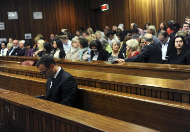 South African Olympic and Paralympic sprinter Oscar Pistorius (front) sits in the dock before the closing arguments in the North Gauteng High Court in Pretoria, August 7, 2014. Pistorius is on trial for murdering his girlfriend Reeva Steenkamp at his suburban Pretoria home on Valentine's Day last year. REUTERS/Werner Beukes/Pool (SOUTH AFRICA - Tags: SPORT CRIME LAW ATHLETICS TPX IMAGES OF THE DAY)