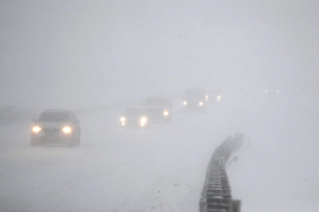 <p>Vehicles commute southbound on the Garden State Parkway in whiteout conditions during a snowstorm, Thursday, Jan. 4, 2018, in Eatontown, N.J. (Photo: Julio Cortez/AP) </p>
