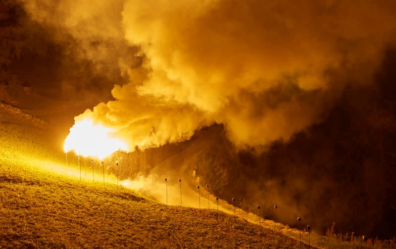 Flares of magnesium powder are pictured during the illumination to celebrate Swiss National Day in Evolene