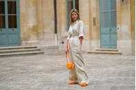 <p>You can never go wrong in a chic linen jumpsuit. Bold orange accessories really let this one run when it might have only walked. </p>