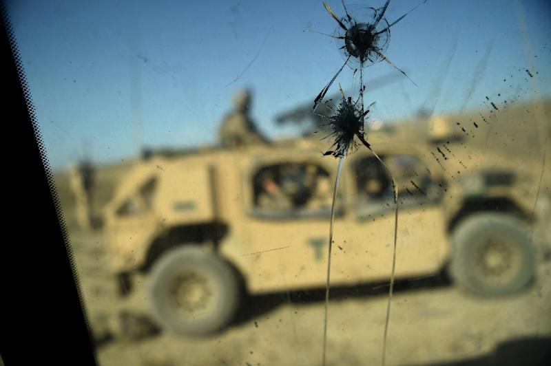 A NATO soldier was killed and two others wounded in an attack that was the latest in a series of such incidents in which Afghan forces have turned their weapons on international troops with whom they are working (AFP Photo/WAKIL KOHSAR)