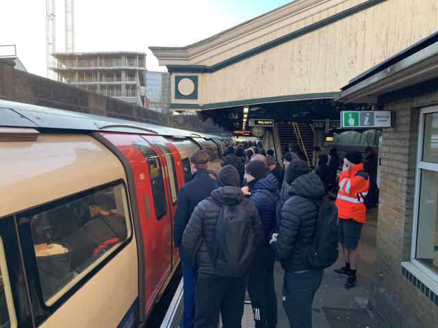 Commuters struggle to get on an already packed Northern Line train at Colindale Station in north London on Monday. (@kubson84/Twitter)