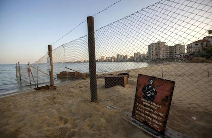 A view of deserted buildings of the tourist area of Varosha, in the fenced off area of Famagusta, in the Turkish-occupied north of the divided eastern Mediterranean island of Cyprus