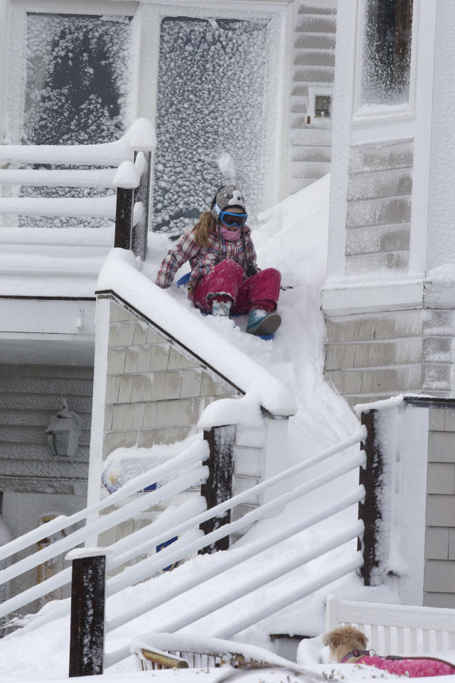 SQUANTUM, MA - FEBRUARY 9: Stairs become slides in the aftermath of the Blizzard of 2013. (Photo by Stan Grossfeld/The Boston Globe via Getty Images)