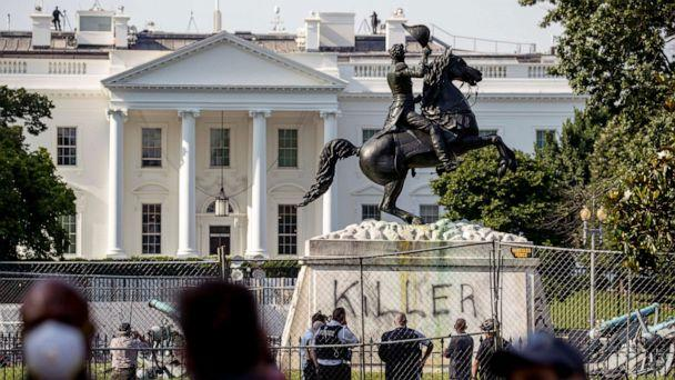 PHOTO: The White House is visible behind a statue of President Andrew Jackson in Lafayette Park, June 23, 2020, in Washington, with the word 'Killer' spray painted on its base. (Andrew Harnik/AP)