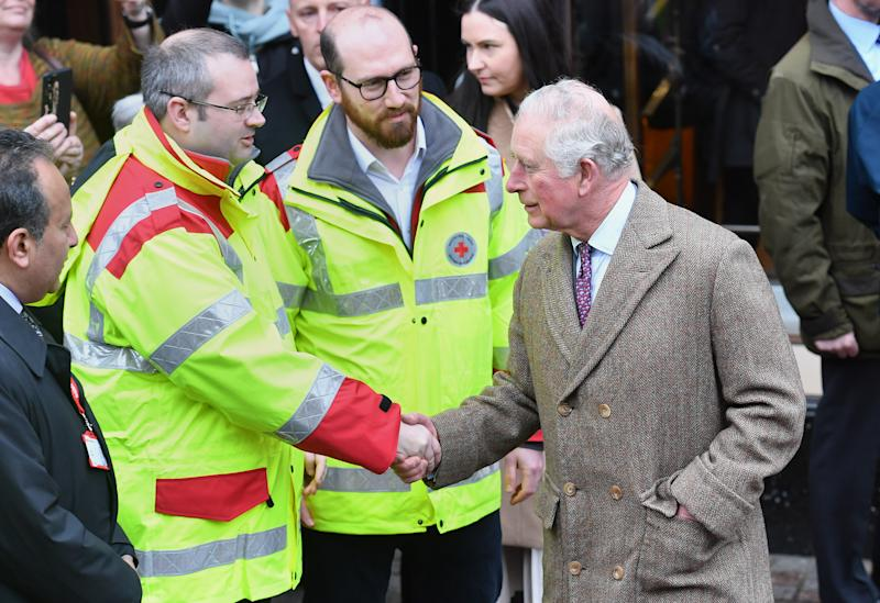 The Prince of Wales meeting first responders during a visit to Pontypridd, Wales, which has suffered from severe flooding in the wake of Storm Dennis.