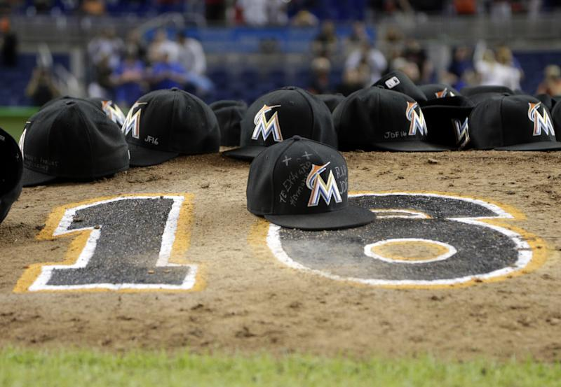 Marlins players left their caps on the mound in honor of Jose Fernandez. (AP)