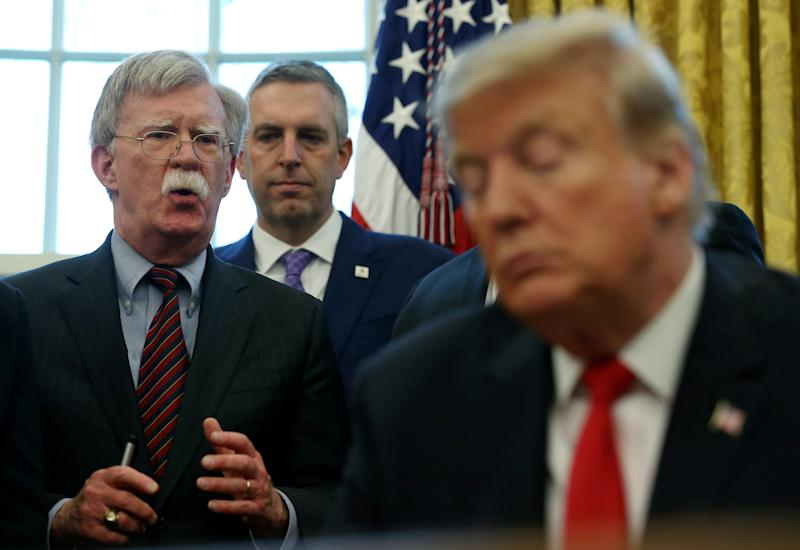President Donald Trump listens as his national security adviser John Bolton speaks during a presidential memorandum signing in the Oval Office at the White House in Washington in February. (Photo: Leah Millis/Reuters)