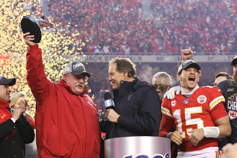 Kansas City Chiefs head coach Andy Reid lifts the Lamar Hunt Trophy over his head as quarterback Patrick Mahomes celebrates after winning the AFC championship on Jan. 19, 2020. (Photo by Scott Winters/Icon Sportswire via Getty Images)