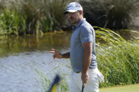Brooks Koepka waves to the crowd after a birdie on the 13th hole during the first round of the PGA Championship golf tournament on the Ocean Course Thursday, May 20, 2021, in Kiawah Island, S.C. (AP Photo/Matt York)