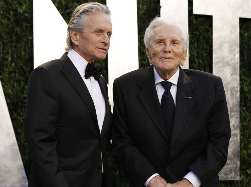 Actor Michael Douglas (L) and his father, actor Kirk Douglas, arrive at the 2012 Vanity Fair Oscar party in West Hollywood, California February 26, 2012. REUTERS/Danny Moloshok (UNITED STATES - Tags: ENTERTAINMENT) (OSCARS-PARTIES)