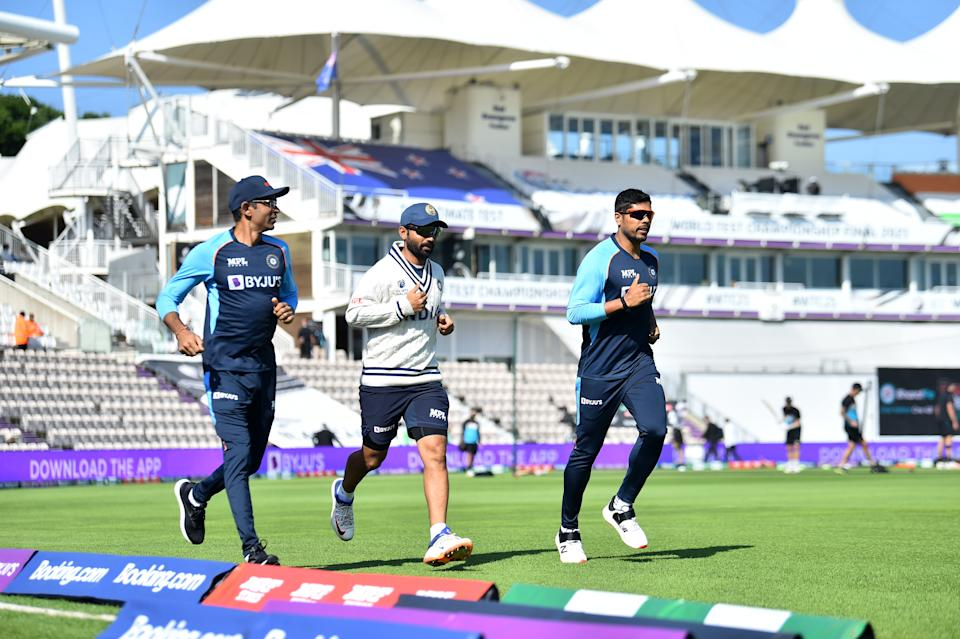 SOUTHAMPTON, ENGLAND - JUNE 23 : Ajinkya Rahane and Umesh Yadav of India warm upduring Day 6 of the ICC World Test Championship Final between India and New Zealand at The Hampshire Bowl on June 23, 2021 in Southampton, England. (Photo by Nathan Stirk-ICC/ICC via Getty Images)