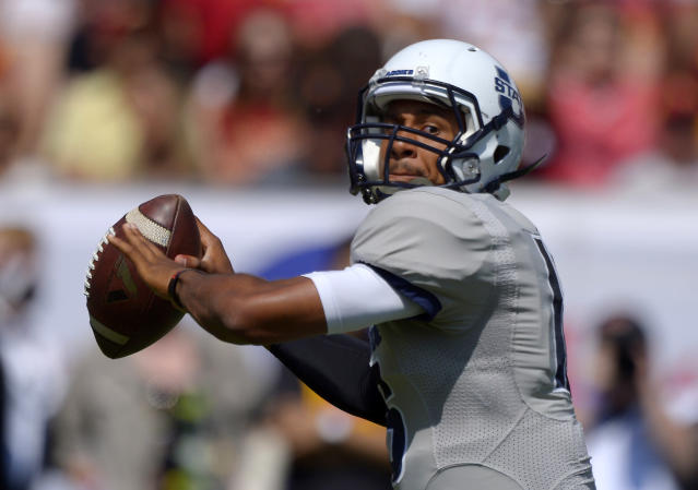 Utah State quarterback Chuckie Keeton passes the ball during the first half of an NCAA college football game against Southern California, Saturday, Sept. 21, 2013, in Los Angeles. (AP Photo/Mark J. Terrill)