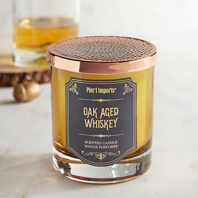 "<p>If dad is a whiskey guy, it might be challenging to buy him a bottle up to his standards, without breaking the bank. Try a cocktail candle instead. The fragrance is bold and woodsy, just like dad imagines himself after a few of those whiskeys.</p> <p><strong><a href=""https://www.pier1.com/oak-aged-whiskey-cocktail-filled-candle/3198227.html?cgid=gifts-for-men#"" rel=""nofollow noopener"" target=""_blank"" data-ylk=""slk:pier1.com"" class=""link rapid-noclick-resp"">pier1.com</a></strong>/$15</p>"