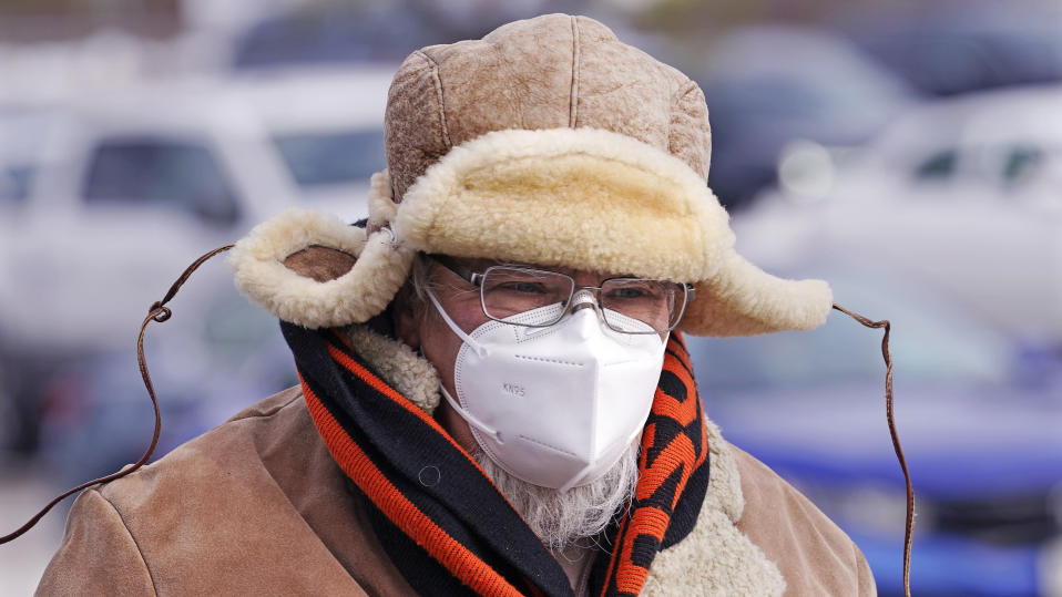 New Hampshire Rep. Sherman Packard, of Londonderry, N.H., walks through the parking lot during an outdoor meeting of the N.H. House of Representatives, due to the COVID-19 virus outbreak, at the University of New Hampshire Wednesday, Jan. 6, 2021, in Durham, N.H. Packard was later elected House Speaker. (AP Photo/Charles Krupa)