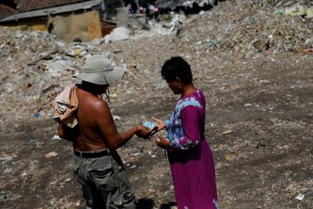 The Wider Image: Cash for trash: Indonesia village banks on waste recycling