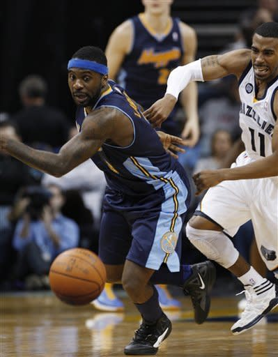 Memphis Grizzlies guard Mike Conley (11) races for the ball with Denver Nuggets guard Ty Lawson in the second half of an NBA basketball game on Tuesday, Jan. 31, 2012, in Memphis, Tenn. (AP Photo/Alan Spearman)