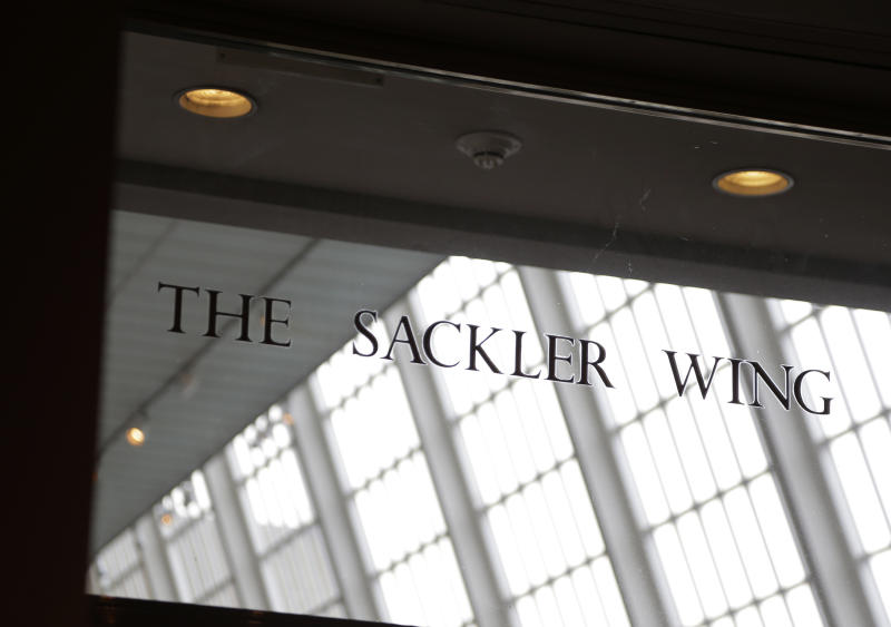 FILE - In this Jan. 17, 2019, file photo, a sign with the Sackler name is displayed at the Metropolitan Museum of Art in New York. Their name used to be on a wing at the Louvre. But now the Sackler family wealth has become linked to sales of OxyContin, and their company, drug maker Purdue Pharma, is attempting to settle lawsuits over the opioid crisis. (AP Photo/Seth Wenig, File)