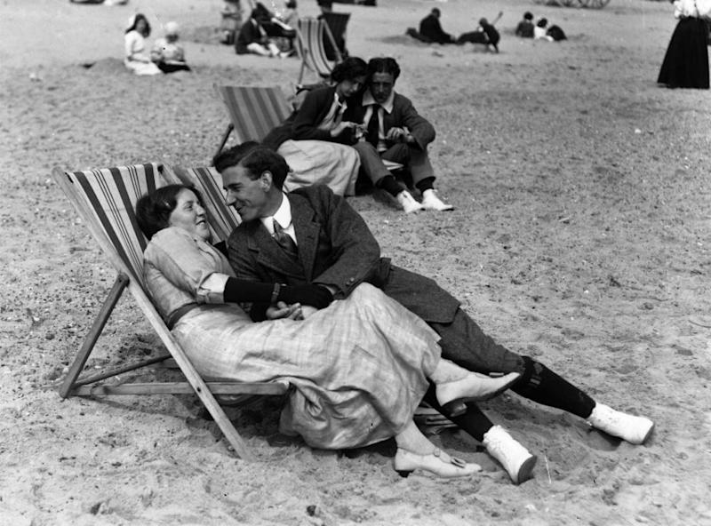 A couple relax in their deckchairs on the beach at Great Yarmouth in 1913 (Getty Images)