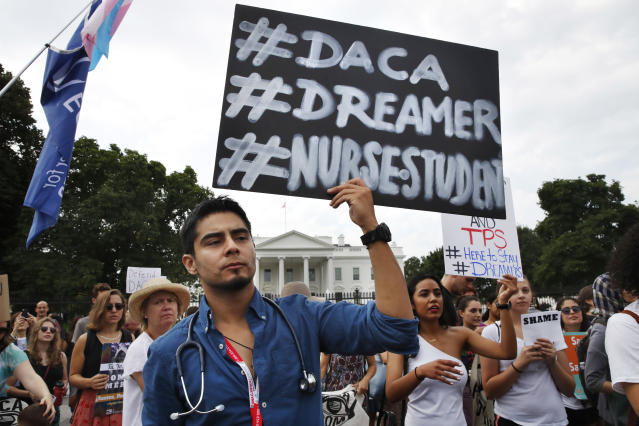 <p>Carlos Esteban, 31, of Woodbridge, Va., a nursing student and recipient of Deferred Action for Childhood Arrivals, known as DACA, rallies with others in support of DACA outside of the White House, in Washington, Tuesday, Sept. 5, 2017. (Photo: Jacquelyn Martin/AP) </p>
