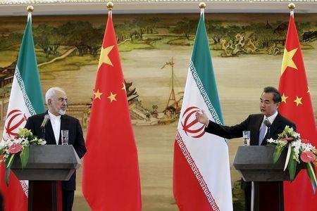 Iranian Foreign Minister Mohammad Javad Zarif and Chinese Foreign Minister Wang Yi attend a news conference after a bilateral meeting in Beijing