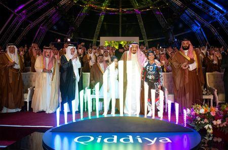Saudi Arabia's King Salman bin Abdulaziz Al Saud (C) and Crown Prince Mohammed bin Salman (R) attend Qiddiya, multi-billion dollar entertainment resort, launching ceremony in Riyadh, Saudi Arabia April 28, 2018.  Bandar Algaloud/Courtesy of Saudi Royal Court/Handout via REUTERS