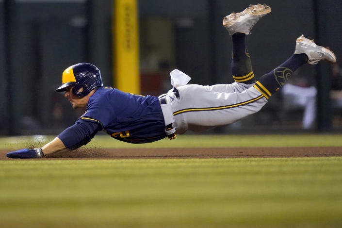 Milwaukee Brewers' Luis Urias advances to third on a base hit by Tyrone Taylor during the seventh inning of a baseball game against the Arizona Diamondbacks, Wednesday, June 23, 2021, in Phoenix. (AP Photo/Matt York)