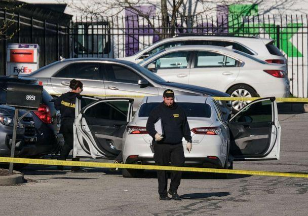 PHOTO: Crime scene investigators walk through the parking lot of the mass shooting site at a FedEx facility in Indianapolis, Indiana, April 16, 2021. (Jeff Dean/AFP via Getty Images, FILE)
