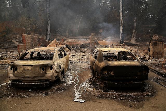 <p>GLBurned cars sit idle after an out of control wildfire moved through the area on October 9, 2017 in Glen Ellen, Calif. (Photo: Justin Sullivan/Getty Images) </p>