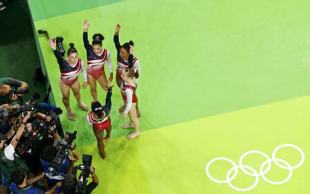 2016 Rio Olympics - Artistic Gymnastics - Final - Women's Team Final - Rio Olympic Arena - Rio de Janeiro, Brazil - 09/08/2016. Simone Biles (USA) of USA, Gabrielle Douglas (USA) of USA (Gabby Douglas), Laurie Hernandez (USA) of USA (393), Alexandra Raisman (USA) of USA (Aly Raisman), Madison Kocian (USA) of USA (C) celebrate winning the gold in the women's team final. REUTERS/Fabrizio Bensch TPX IMAGES OF THE DAY. FOR EDITORIAL USE ONLY. NOT FOR SALE FOR MARKETING OR ADVERTISING CAMPAIGNS.