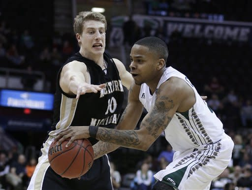 Ohio's D.J. Cooper, right, drives to the basket against Western Michigan's Brandon Pokley during the second half of an NCAA college basketball game in the semifinals of the Mid-American Conference men's tournament Friday, March 15, 2013, in Cleveland. Ohio won 74-63. (AP Photo/Tony Dejak)