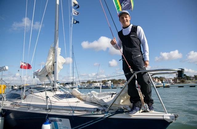 Timothy Long poses for a photograph on his 28ft boat Alchemy after arriving back into Hamble Point Marina, Hampshire
