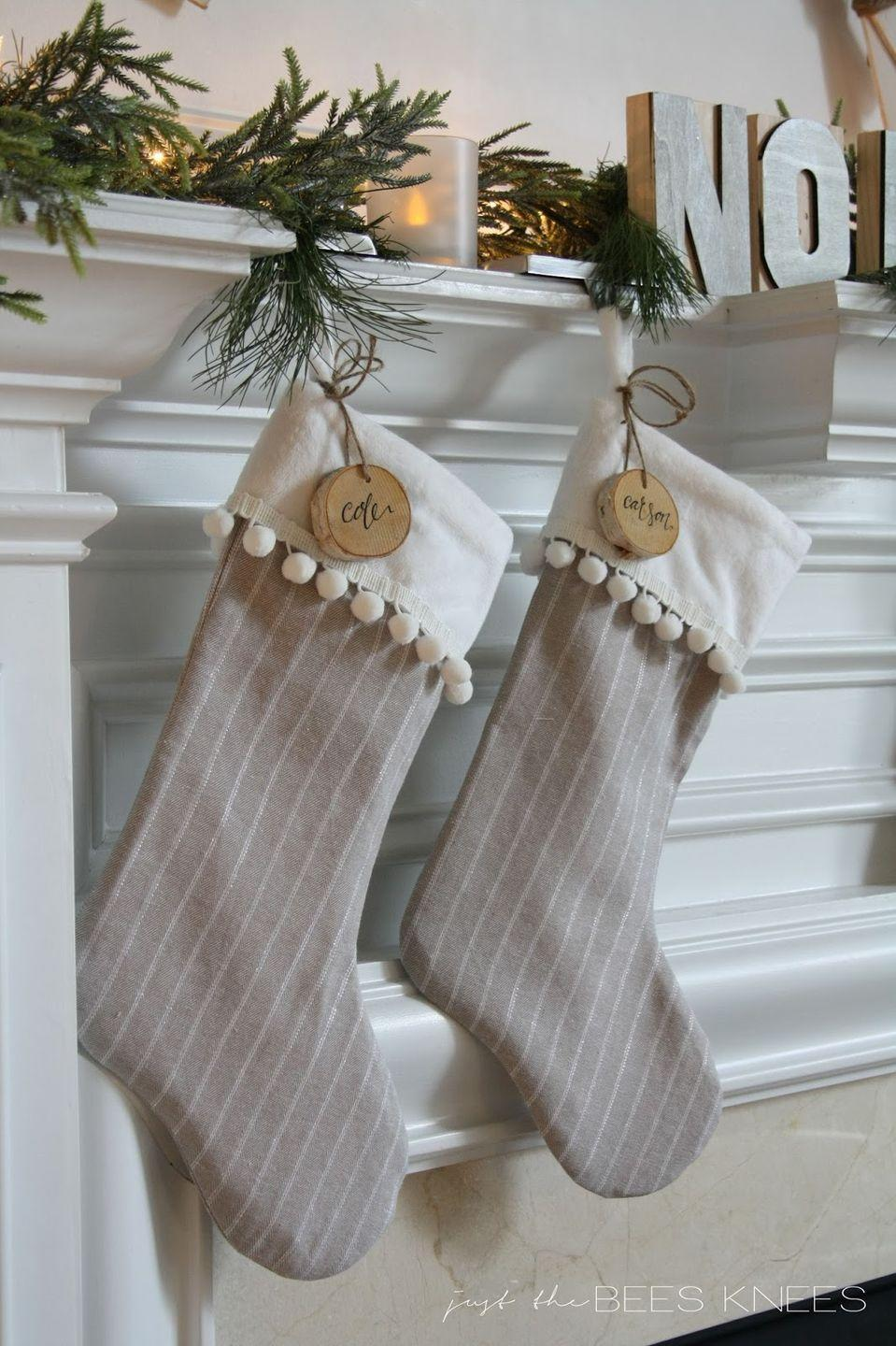 """<p>Before hanging, add some custom tags using <a href=""""https://www.amazon.com/Assorted-Decorations-Ornaments-Super-Outlet/dp/B01FRDI8EY/?tag=syn-yahoo-20&ascsubtag=%5Bartid%7C10050.g.1407%5Bsrc%7Cyahoo-us"""" rel=""""nofollow noopener"""" target=""""_blank"""" data-ylk=""""slk:birch slices"""" class=""""link rapid-noclick-resp"""">birch slices</a> and a sharpie for an adorably festive touch. </p><p><strong>Get the tutorial at <a href=""""http://www.justthebeesknees.com/2014/12/diy-pom-pom-trim-stocking-tutorial.html#_a5y_p=4567071"""" rel=""""nofollow noopener"""" target=""""_blank"""" data-ylk=""""slk:Just The Bee's Knees"""" class=""""link rapid-noclick-resp"""">Just The Bee's Knees</a></strong><strong>.</strong></p><p><strong><a class=""""link rapid-noclick-resp"""" href=""""https://www.amazon.com/Assorted-Decorations-Ornaments-Super-Outlet/dp/B01FRDI8EY/?tag=syn-yahoo-20&ascsubtag=%5Bartid%7C10050.g.1407%5Bsrc%7Cyahoo-us"""" rel=""""nofollow noopener"""" target=""""_blank"""" data-ylk=""""slk:SHOP WOOD SLICES"""">SHOP WOOD SLICES</a><br></strong></p>"""